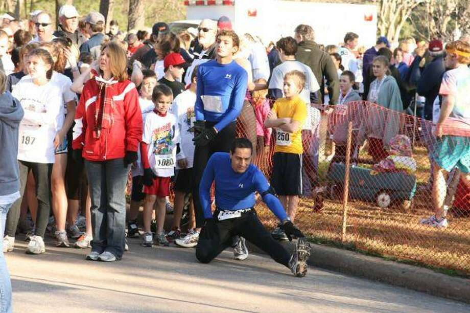 Runners stretch at the starting line before the start of the 5K Family Run and Walk as a part of the 18th annual YMCA Bridge Fest Feb. 6.