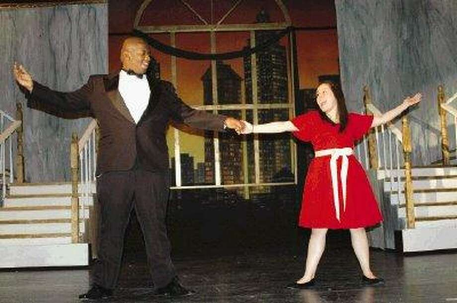 "Hazel Cortez as Little Orphan Annie, with Charles Vaughn as Daddy Warbucks in the North Shore High School production of ""Annie."""