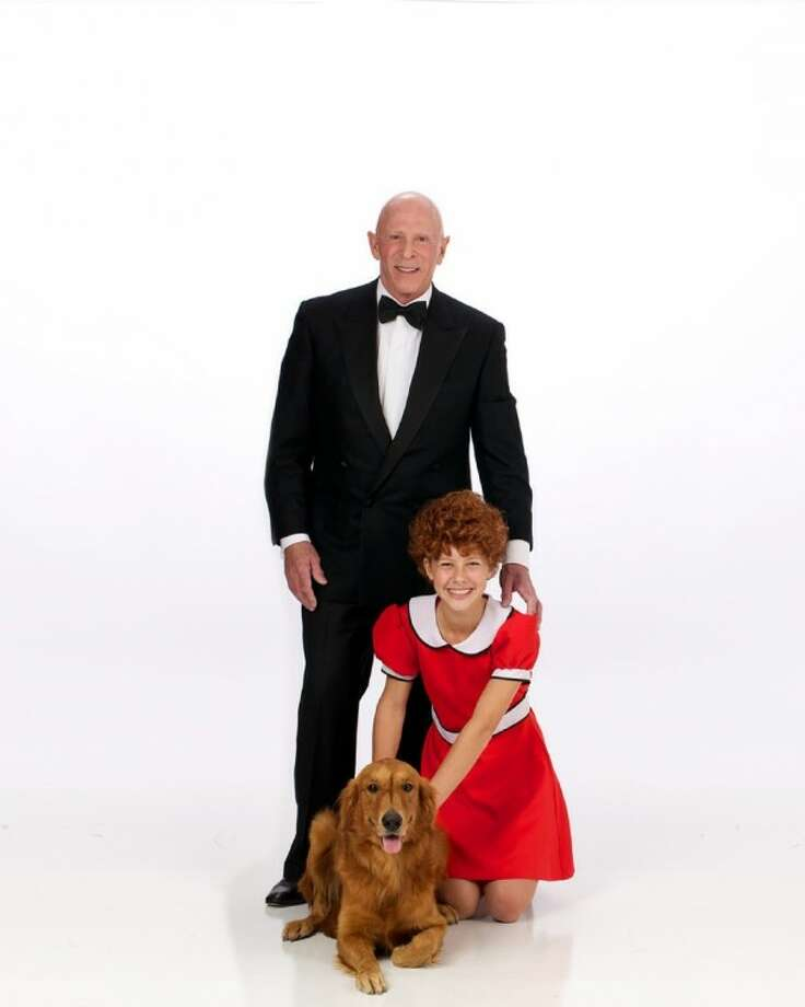 """Everyone's favorite redhead orphan, her adorable dog Sandy, and Daddy Warbucks in the seven-time Tony Award winning production """"Annie."""" Theatre Under The Stars will present """"Annie"""" from March 20 through April 1 at the Hobby Center for The Performing Arts. (Photo by Claire McAdams for Theatre Under The Stars)"""
