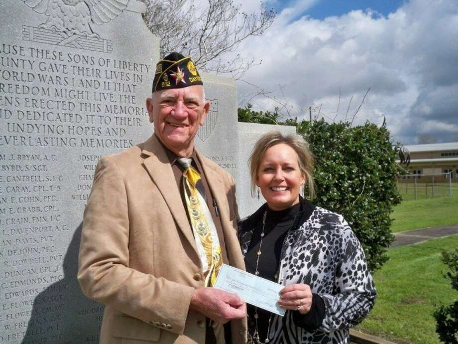 """Dayton American Legion Post 512 Commander Charles Grabein presents a $500 donation to the Veterans War Memorial Monument Improvement Project on Feb. 27 at the Liberty monument. Liberty Independent School District Superintendent Dr. Cynthia Lusignolo accepts the donation, every cent of which is dedicated to the continuing costs of lighting, water for the landscaping and additional maintenance, now that the $20,000 construction goal has been surpassed. Donations are still being accepted. Checks should be made payable to """"Liberty ISD"""" and delivered either to the Liberty ISD Administration Building, 1600 Grand Ave., Liberty, TX 77575 or to the law offices of Pickett & Pickett, 524 N. Travis St., Liberty, TX 77575. Photo: SUBMITTED PHOTO"""