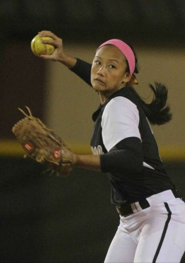 Conroe's Libby Iniguez throws to first during a high school softball game at Conroe. The Woodlands defeated Conroe 31-2. To view or order this photo, or others like it, visit: HCNPics.com