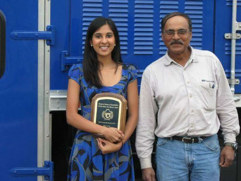 Samantha Fernandes, with her father Tony Fernandes, recently won a Team Industrial Services scholarship. Fernandes is a student at the University of Texas majoring in chemical engineering.