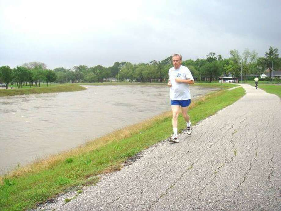 Jogging instead of paddling along Brays Bayou, thanks to successful flood control.