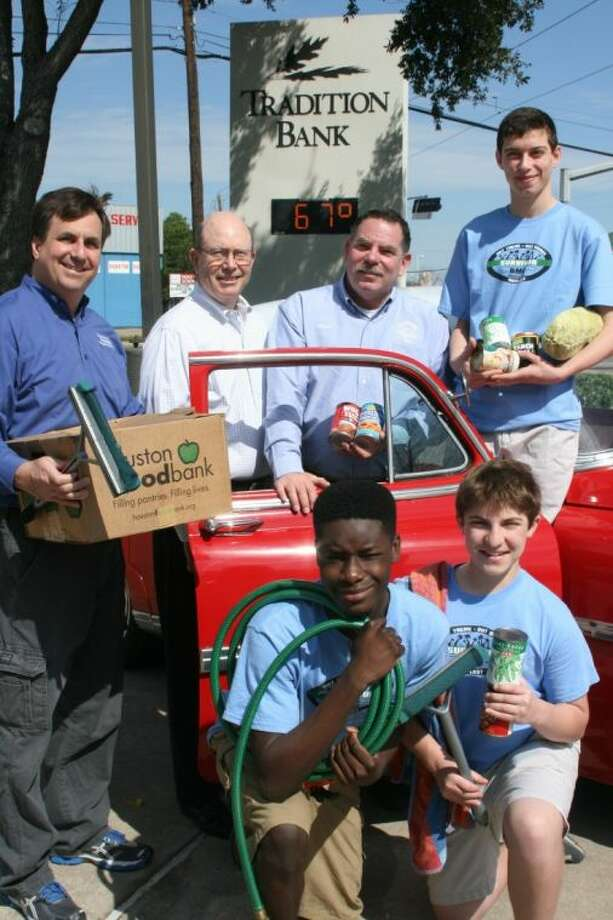 Houston Food Bank CEO Brian Greene (left), Tradition Bank CEO Craig Wooten, Bellaire Mayor Dr. Phil Nauert, Bellaire High School sophomore and car wash co-chair Cole Holan, Lamar High School and car wash co-chair Dante Agbontaen and Cole Introligator, sophomore from Carnegie Vanguard and car wash co-chair get ready for the Bellaire Mens Club Canned Goods Car Wash on Saturday, March 2. Photo: Submitted