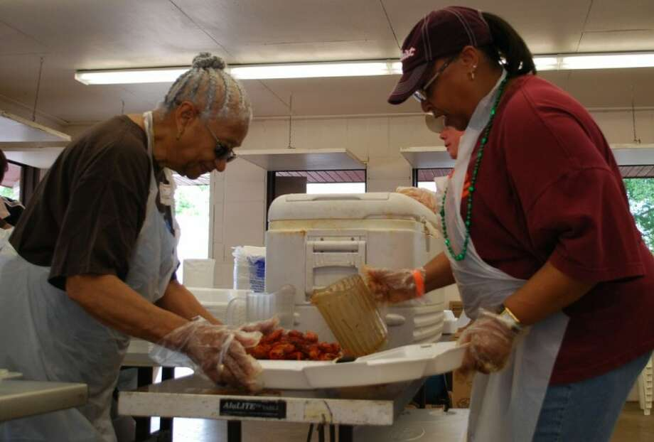 Volunteers from the African Methodist Episcopal Church in Clear Lake spent Saturday afternoon serving up crawfish to the crowd at the Clear Lake Area Chamber of Commerce's annual Crawfish Festival.
