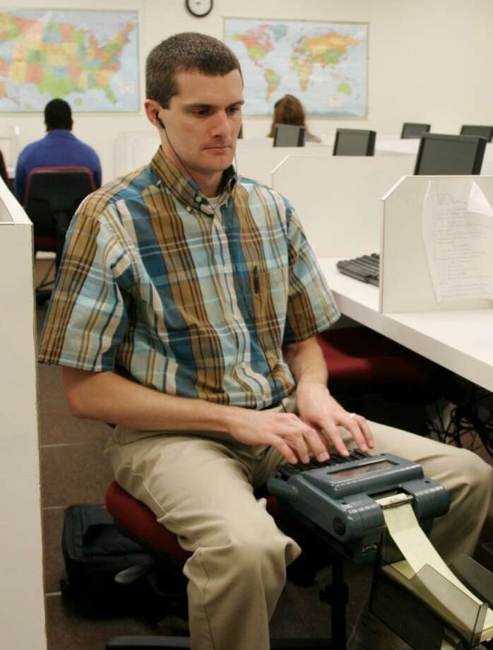 Alvin Community College Court Reporting student John Partain, of Alvin, practices before class on April 4. For the past two years, John has participated in the United States Library of Congress Veterans History Project by transcribing personal testimonies.