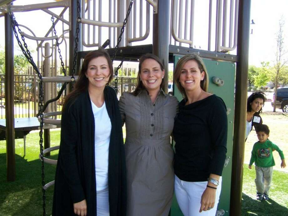 """Organizers of this year's Friends of West U Parks urban campout, """"Fathers and Flashlights,"""" include (from left) Sara Edgecomb, Maggie Garza and Amanda McGee."""