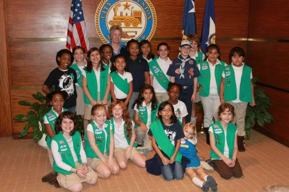 "Mayor Annise Parker recently sat down with Girl Scout Junior Troop 20281 from the Lansdale Service Unit. These girls were working on the ""Inside Government"" badge. They began in November, learning about voting and following the recent election. Parker sat down with the troop and explained to the girls how she runs the city of Houston. They learned how they can be active citizens, by following the laws and paying taxes on their purchases. The mayor let the girls know that by being active citizens, they help her take care of Houston's 2 million citizens every day, from garbage collection to fire protection. Photo: Submitted"