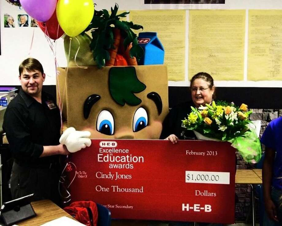 Cindy Jones poses for photos after receiving the news that she is a finalist for the 2013 H-E-B Excellence in Education Awards.