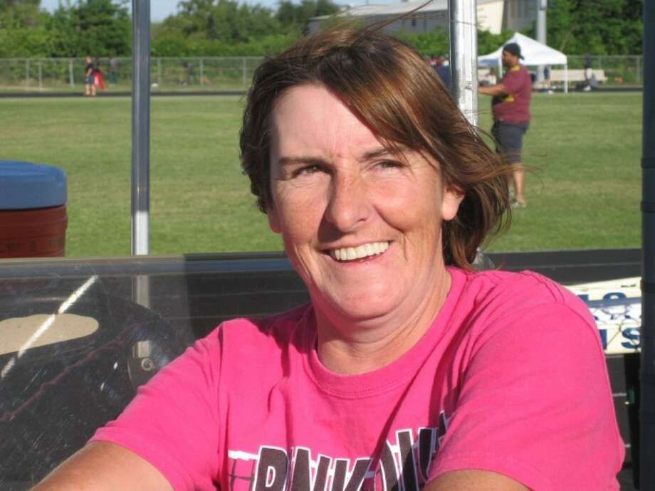 Cy Ridge High fan Janice Travers is a dedicated Rams' fan. (Photo by MICHAEL SUDHALTER/The Sun).