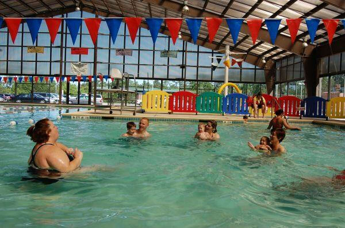 Corey Lenon teaches a parent-child swim class for children from 6 to 36 months in age at the Lake Houston Family YMCA.