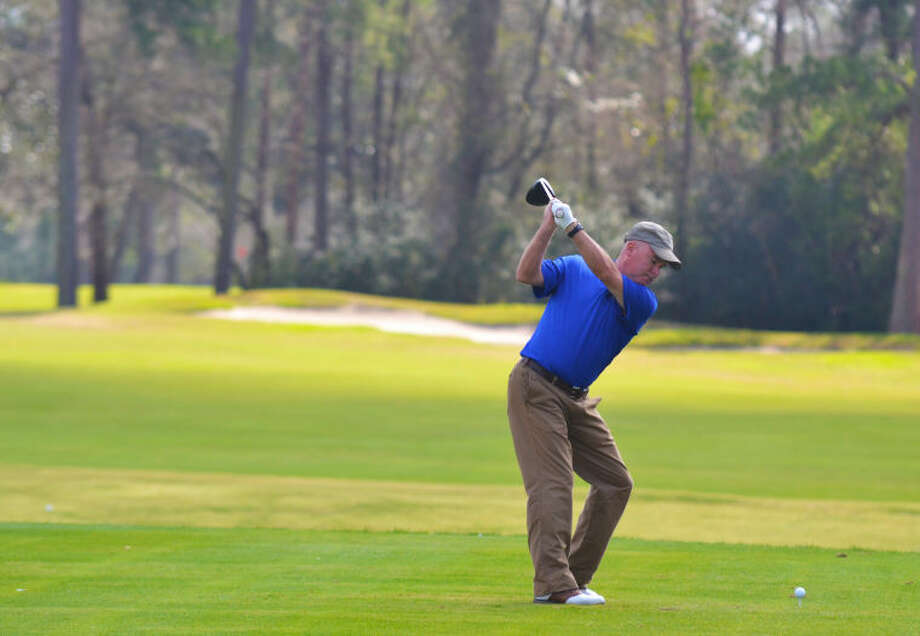 A golfer tees off during the Humble ISD Golf Classic held at the Kingwood Country Club on Feb. 18, 2013. Photo: Stephen Whitfield