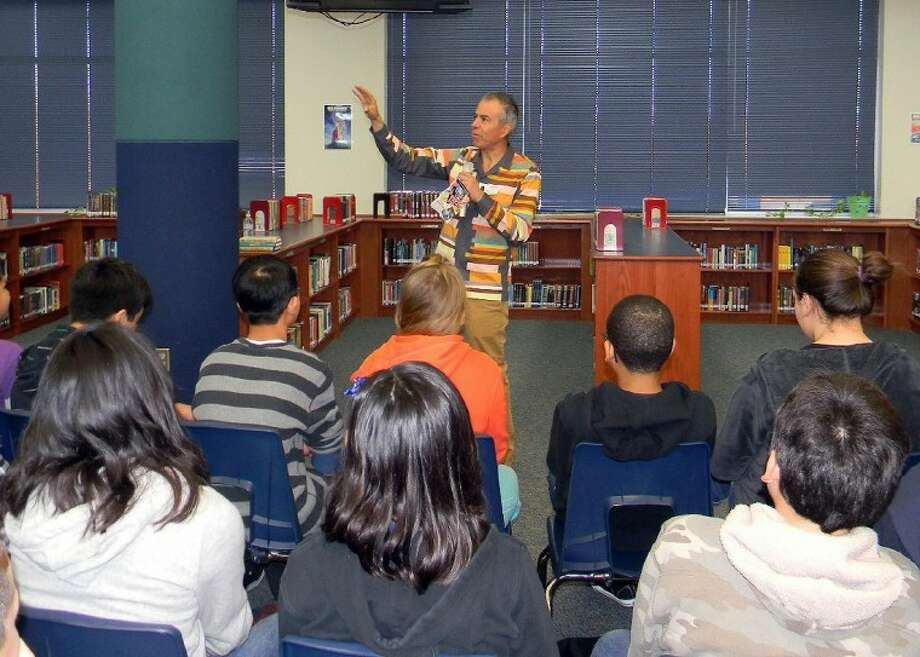 Author Gary Soto speaks to students at Baines Middle School.