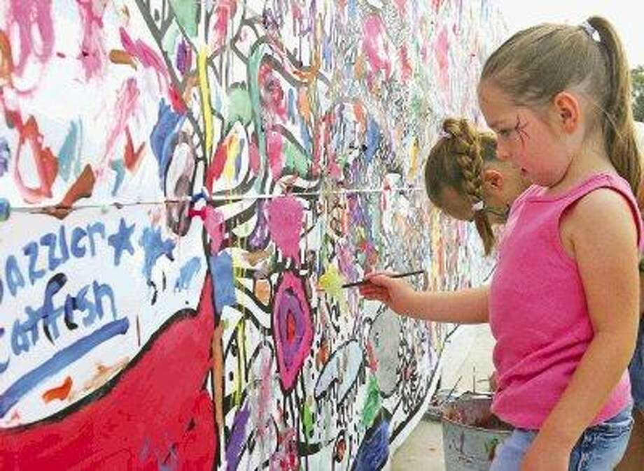 """The """"art wall"""" at the Conroe Cajun Catfish Festival is just one of the fun events for kids. This year marks the 20th anniversary of the festival. / @WireImgId=727817"""