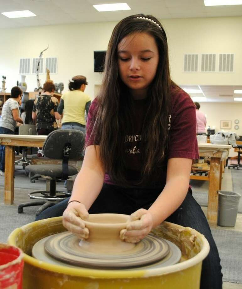 Pearland Homeschool Alliance student Macy Patric, 12, of League City, uses a pottery wheel to make a bowl on Friday, February 24 at the Alvin Community College art building. Photo: ACC