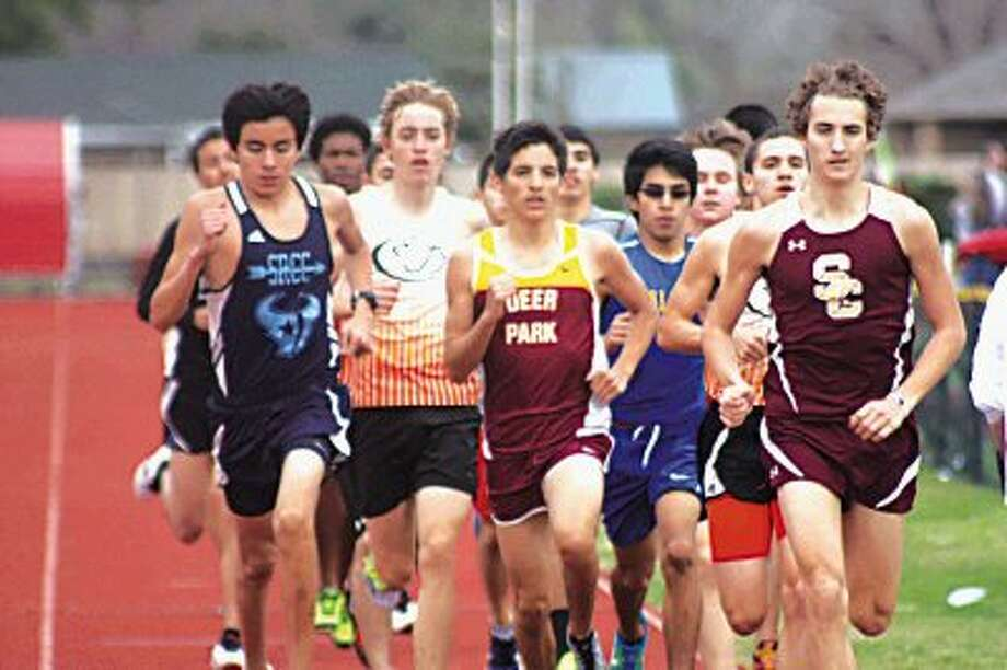 The 3200-meter boys field completes another lap Friday's annual Brown Relays at Auxiliary Stadium. Summer Creek High School's Jake Bootz, far right, successfully defended his 3200-meter title from a year ago with a 9:59.87 run.