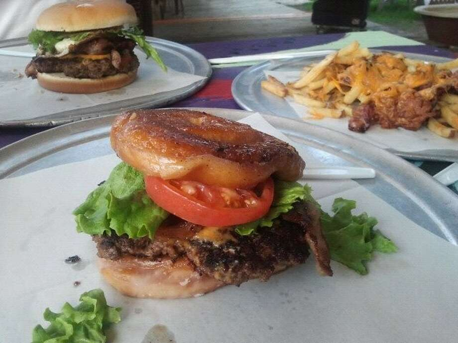 The Grease and Weasel burger at The Shack replaces the traditional hamburger bun with two donuts for a unique sweet-and-salty creation.