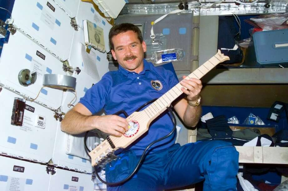 """Space Station Expedition 35 commander Chris Hadfield is pictured. On Wednesday, the Cynthia Woods Mitchell Pavilion opens it 2011 Performing Arts Season with an """"Out of this World"""" space-themed concert. Hadfield will be a special guest at the concert."""