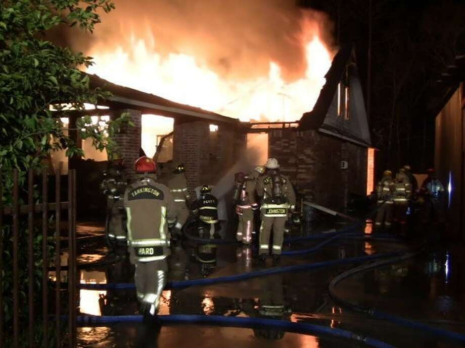 Firefighters from neighboring departments worked together to contain a house fire on Gulf Road, which took more than four hours to contain. Photo: Submitted Photo