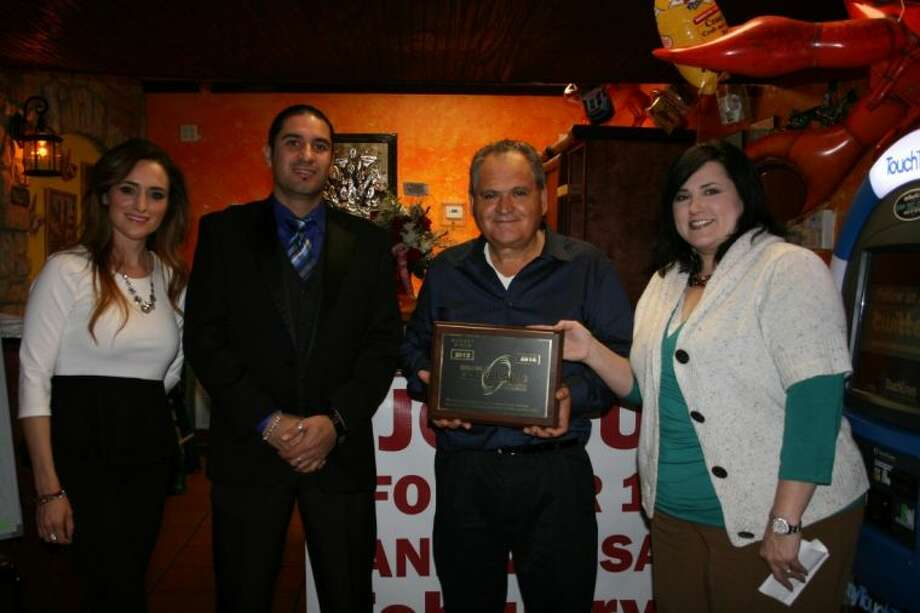 Cleveland restaurant, 7 Leguas, is owned by family members Nadia Ruiz, Martin Lopez, and Herbirto Ruiz. Tracey Walters, CEO of the Cleveland Chamber of Commerce, attended a ribbon-cutting ceremony celebrating the restaurant's one year of operation. Photo: STEPHANIE BUCKNER