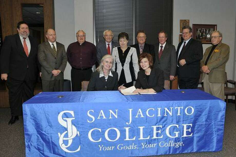 San Jacinto CollegeDr. Brenda Hellyer (seated, right) signed an articulation agreement with the University of Texas Medical Branch at the January 2010 meeting of the Board of Trustees. Also at the signing were (back row, left to right): Dr. H. Neil Matkin, President, San Jacinto College Central; Dan Mims, Member, San Jacinto College Board of Trustees; Larry Vandiver, respiratory care program director, San Jacinto College; Wayne Slovacek, Member, San Jacinto College Board of Trustees; Marie Flickinger, Chair, San Jacinto College Board of Trustees; Larry Wilson, Assistant Secretary, San Jacinto College Board of Trustees; Ben Meador, Secretary, San Jacinto College Board of Trustees; John Moon Jr., Member, San Jacinto College Board of Trustees; Dr. Ruede Wheeler, Member, San Jacinto College Board of Trustees; (seated, from left to right): Dr. Barbara Hanson, Vice President of Instruction, San Jacinto College Central Campus; Dr. Brenda Hellyer, Chancellor, San Jacinto College.