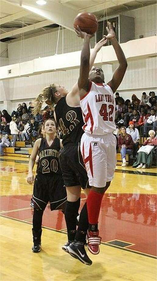 Cleveland center Audrisa Harrison makes a jump shot during the Friday night's win over the Tarkington Lady Longhorns. The Lady Horns struggled to contain Harrison, who finished the game with 22 points.