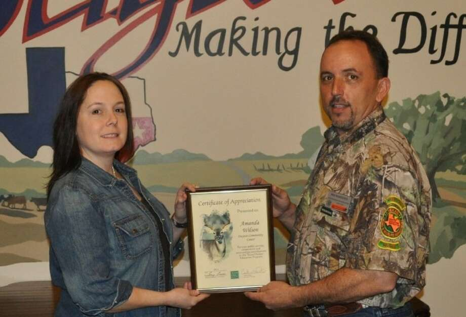 Brent Beamesderfer, Texas Parks and Wildlife Hunter Education instructor presents Dayton Community Center Facility Director Amanda Wilson a certificate of appreciation. Photo: SUBMITTED PHOTO