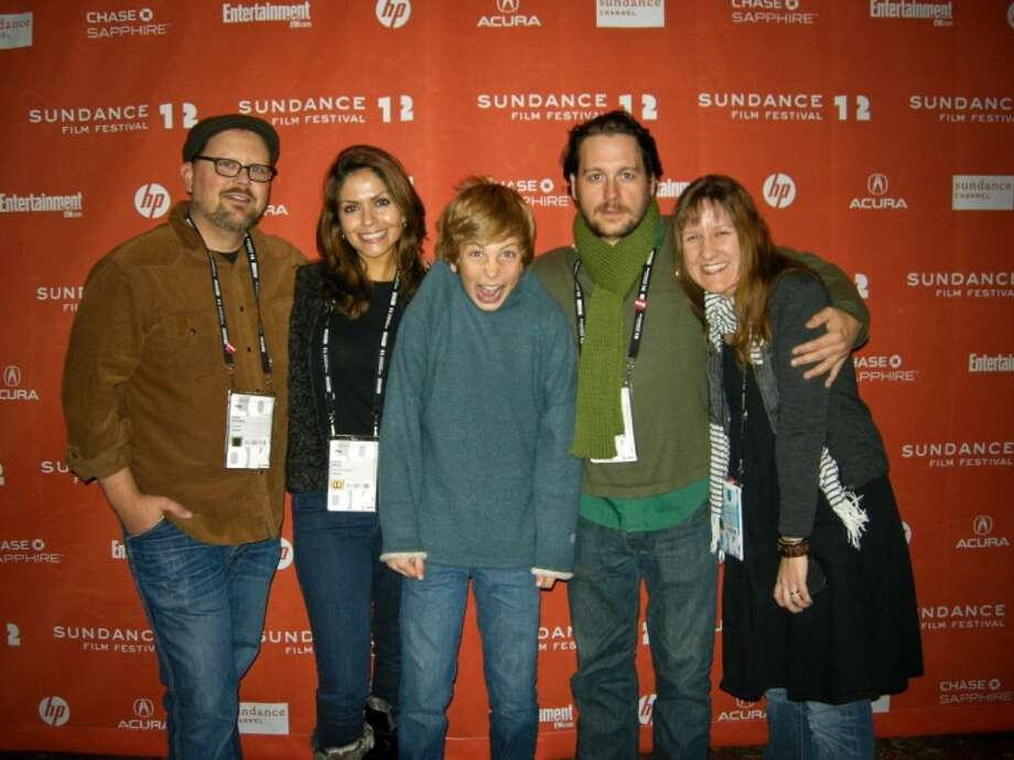 Tommy Hohl (center), a 13-year-old Hamilton Middle School student, goofs off with his co-workers from Hellion (from left to right), producer Kelly Williams, executive producer Farah White, actor Jonny Mars and director Kat Candler, at the Sundance Film Festival in Park City, Utah this past January.