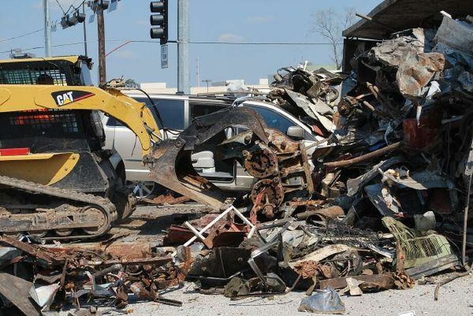 A woman and child escaped uninjured after an 18-wheeler dumped a load of scrap metal on top of a van March 4.