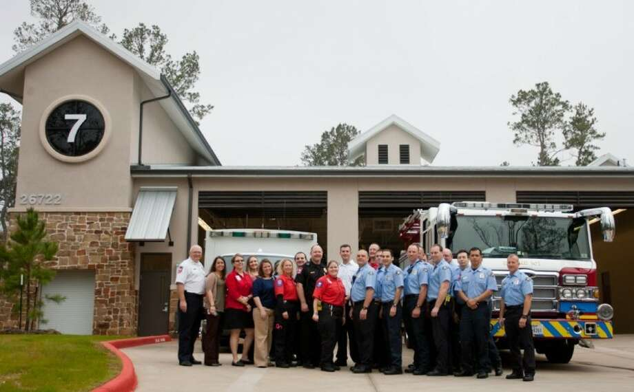 Firefighters and EMS staff stand for a photograph outside The Woodlands Fire Department Station 7 on Kuykendahl Road. The station will serve Creekside Park, Indian Springs and Sterling Ridge. Photo: Staff Photo By Eric S. Swist