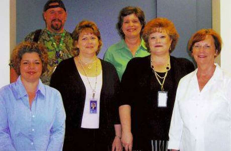 Honored as Kingwood High School's Super Staffers during the 2007-2008 school year were, from left, Michelle Perkins, instructional technology support; Robert Evans, custodian; Dawn Riggins, counselors' secretary; Cindy Rugeley, audio visual aide; Teresa Duensing, data entry; and Donna Belger, assistant principal's secretary.