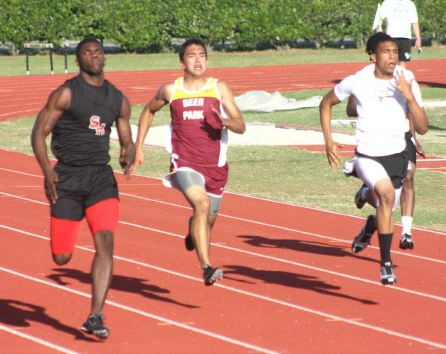 South Houston's Kenneth Marshall finds himself in the lead during his heat for the 200-meter run Tuesday night. Marshall more than won his heat, he claimed the fastest time for tonight's running finals.