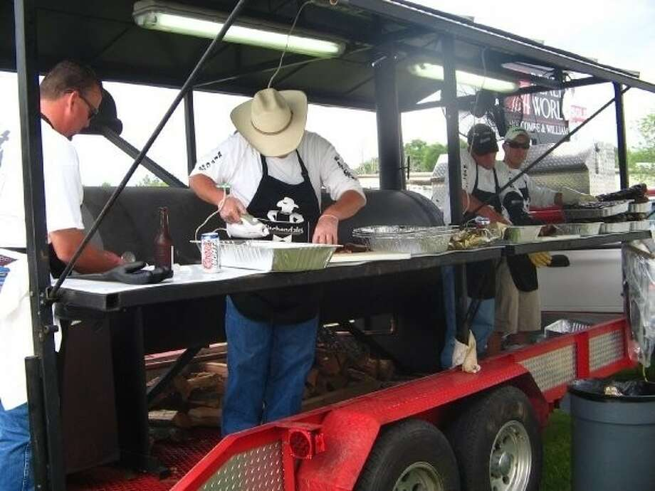 Cooking teams, like this one in 2011, will compete for cash payouts at the 18th annual Magnolia Showdown BBQ Cook-off at Unity Park March 30-31.