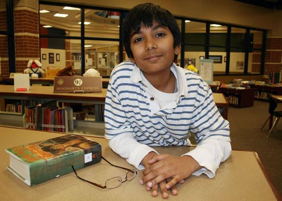 Spring ISD Spelling Bee winner, Bilal Syed, is pictured in the Northgate Crossing Elementary School library, where he likes to read Harry Potter books.