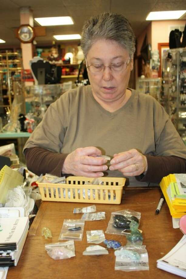 In addition to jewelry and art supplies, Cora Standley sells many unique items at her store including these semi-precious stones that have been carved into shapes such as butterflies and hearts. She also sells geodes and fossils. Photo: MELECIO FRANCO