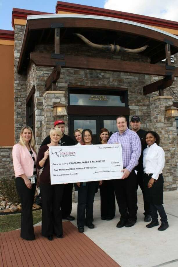 Michelle Smith, Parks & Recreation Director; and Carry Capers, Resource Development Manager; joined Sean Carroll, Managing Partner of LongHorn Steakhouse and LongHorn Steakhouse staff for a check presentation to the department. Photo: SUBMITTED PHOTO