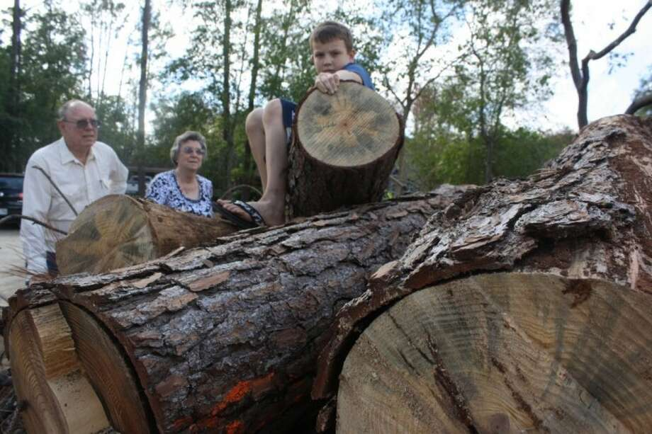 The Robinsons (pictured with their grandson) moved into their home on Fox Meadow because they loved the pine trees that filled the property. Since late last year, about ninety percent of those trees have been decimated by the drought. Photo: Y.C. Orozco