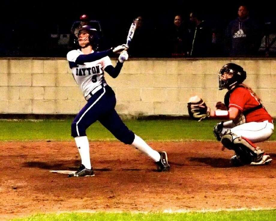 Presley Bell batting for Dayton Friday night, Feb. 22. Her fly ball in the last inning was caught by Crosby third baseman Alexis Balderama. Photo: CASEY STINNETT