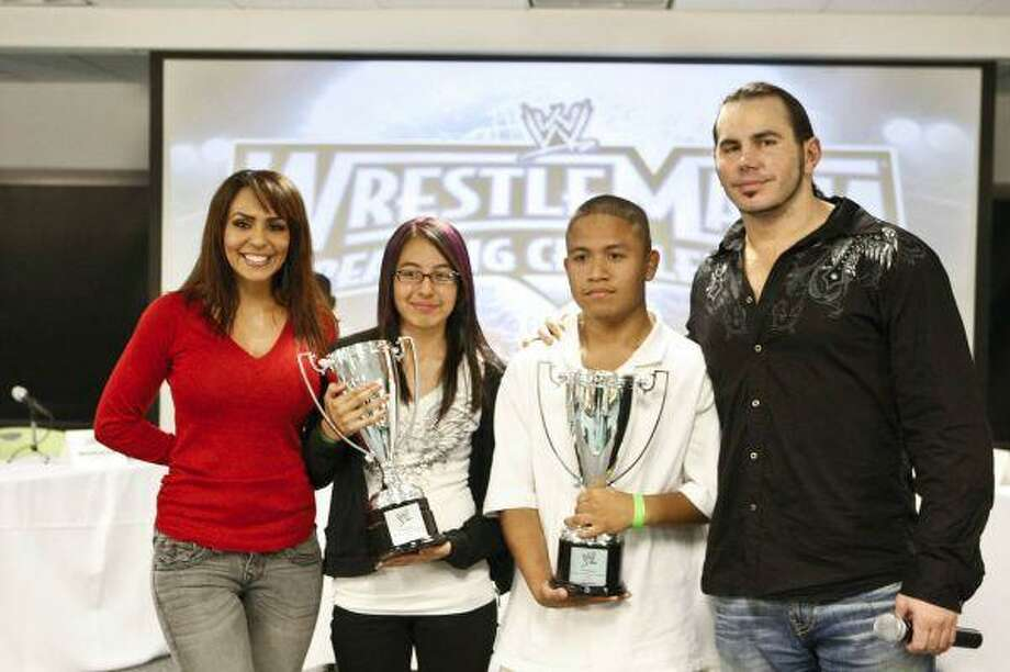 Christian Cervantes and Stephanie Diaz, both from Houston, are pictured with WWE Superstars Matt Hardy and Diva Layla.