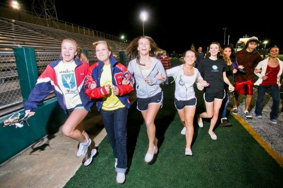 Clear Lake High students Emilie Scott, Sally McGahee, Katherine Foley, Cara Clayton and Dee Balionis get into the ' Walk for Haiti' spirit.