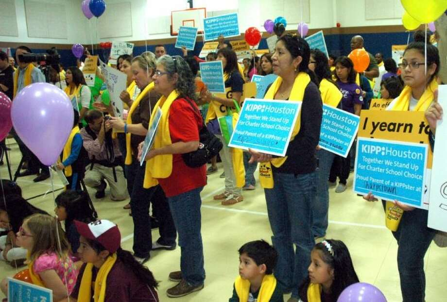 Parents and students listen to remarks at Saturday's school choice rally.