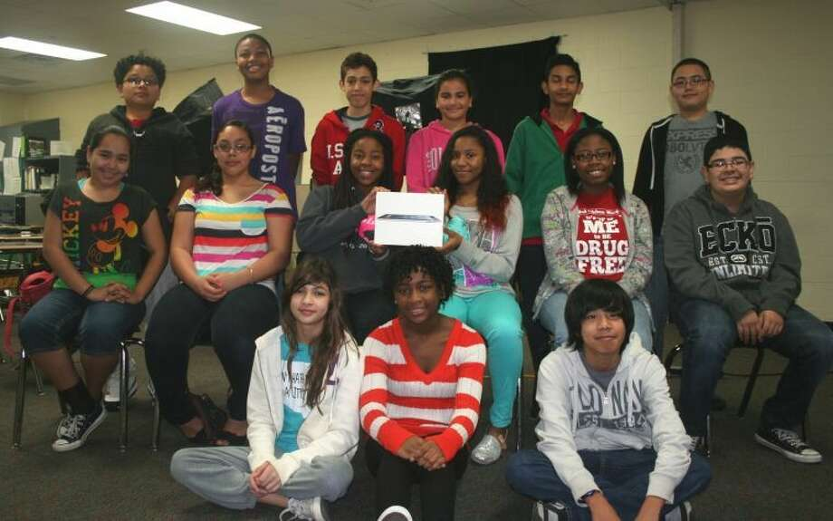 Pictured are Crockett's Broadcast Class students, who were named winners of the VBrick Student Video Contest. Shown (front row, from left) are: seventh-graders Vanessa Ramos, Imani Rhodes, Lance Sy-Changco; (second row) eighth-graders Jasmine Gonzalez, Brittany Onwenu, Maria Ramirez, Da'Jion Douressaux, Zakiyya Muhammad, Christian Olvera; and (back row) seventh-graders Jimmy Amandor, Daelan Davidson, Michael Duran, Layal Hamadeh, Mit Mehta and Martin Ramos. Photo: Submitted Photo