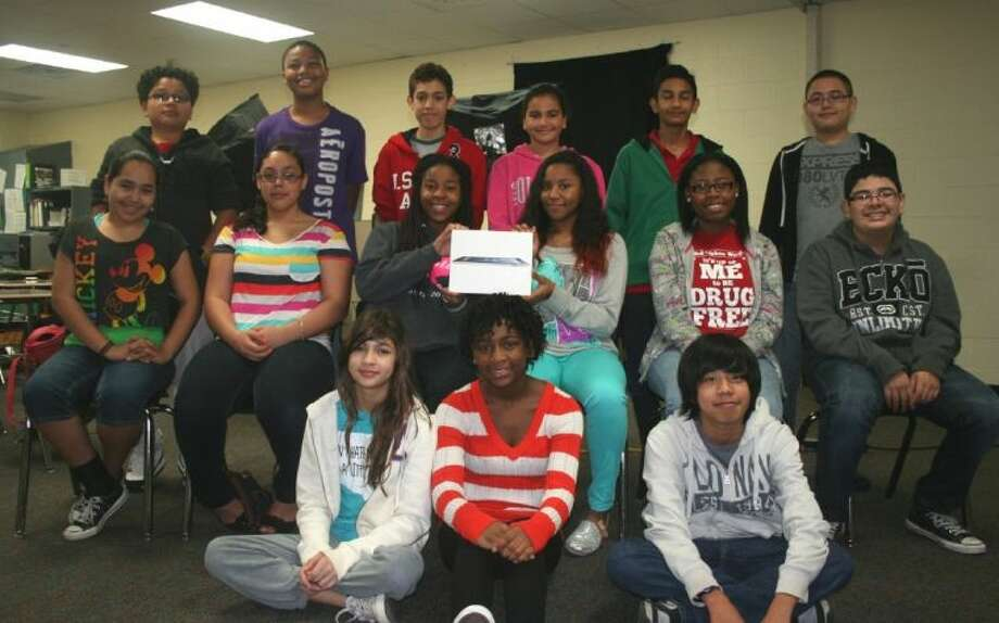 Pictured are Crockett's Broadcast Class students, who were named winners of the VBrick Student Video Contest. Shown (front row, from left) are: seventh-graders Vanessa Ramos, Imani Rhodes, Lance Sy-Changco; (second row) eighth-graders Jasmine Gonzalez, Brittany Onwenu, Maria Ramirez, Da'Jion Douressaux, Zakiyya Muhammad, Christian Olvera; and (back row) seventh-graders Jimmy Amandor, Daelan Davidson, Michael Duran, Layal Hamadeh, Mit Mehta and Martin Ramos.