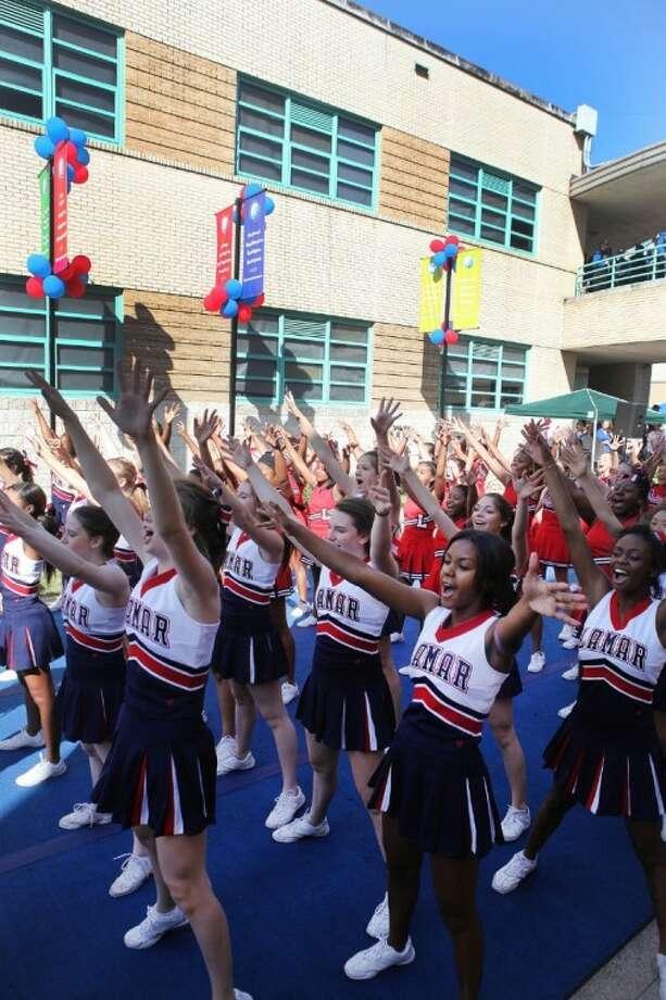 Lamar Cheerleaders perform during pep rally at the Lamar High School 75th Anniversary celebration in Houston on Saturday, Oct. 20. Photo: Alan Warren
