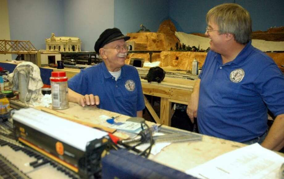 Jimmy Beeman (left) and Tom Lytle of the Houston Tinplate Operators Society Saturday at HTOS's last public run in Memorial City Mall. HTOS has to vacate the space by the end of February. Photo: Rusty Graham