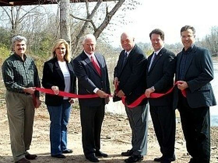 An official Ribbon Cutting Ceremony for the County's two new canoe launches was held on Monday, Feb. 6, at 2 p.m. attended by L-R: Sidney Alfonso, KBR; Jane Stockton, City Council, City of Simonton; John Van De Wiele, Fort Bend Green; Bob Hebert, County Judge; Jeff Wiley, Greater Fort Bend Economic Development Council; and Eric Hall, KBR.