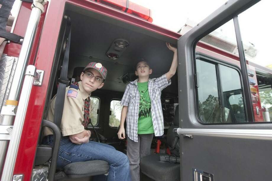 A.J. Ollis and Blake Hliva tour a fire truck during the grand opening of fire station 77 in Spring on Saturday. Photo: Karl Anderson