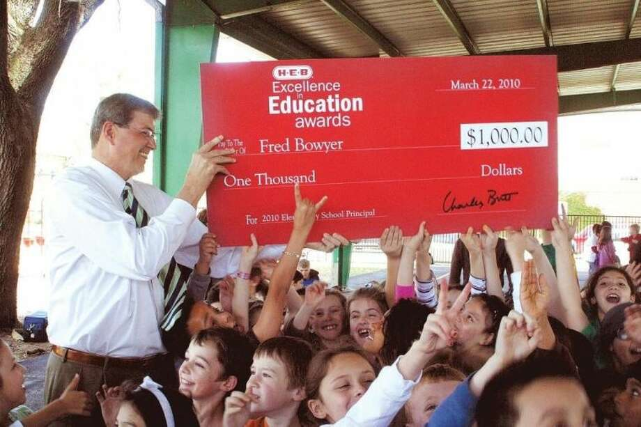 Condit Elementary students surprised Principal Fred Bowyer in March 2010 with a school assembly to recognize his selection as a finalist in the HEB Excellence in Education Awards. Bowyer will retire Feb. 8 after nearly three decades in HISD, including 13 years as Condit principal. Photo: Examiner File Photo