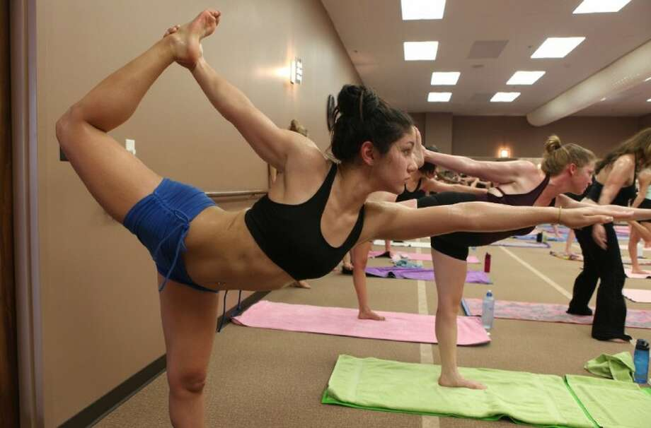 Photo by Alan Warren/The RancherStudents stretch in a room heated to 105 degrees during a Saturday morning session at Bikram Yoga in Katy on Feb. 24. Photo: Photo By Alan Warren