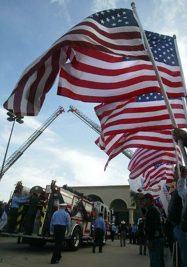 Flags line the route to Grace Community Church.